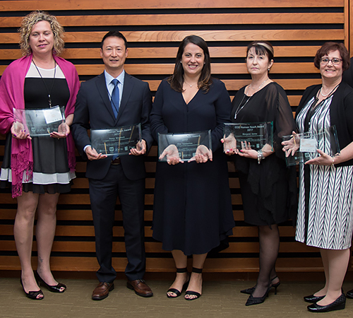 Human Touch Awards recipients in the cancer care category: From left, Julie Chaves, Dr. Michael Lock, Elise Gasbarrino, Margaret Genna and Debora Prokopich Buzzi